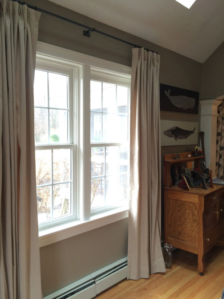 Linen curtains provide beauty and privacy. on Lundy's of Lynn custom Iron hardware